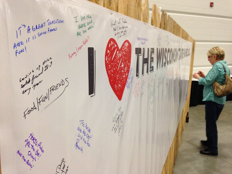 An attendee signs in why she loves the Wisconsin State Fair at last night's 100 Days to the Fair Preview.