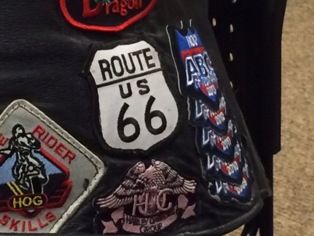 A rider's vest tells the story of where they've been.