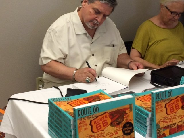 Author Michael Wallis signs copies of his book detailing the history of Route 66.