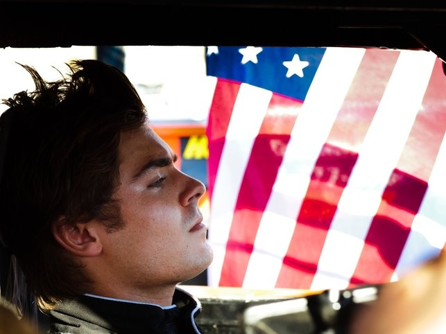 "Zac Efron stars as wannabe race car driver Dean Whipple in ""At Any Price,"" now playing."