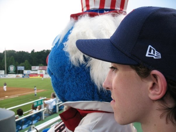 Taking in a game with my new friend Uncle Slam, the mascot of the Potomac Nationals.