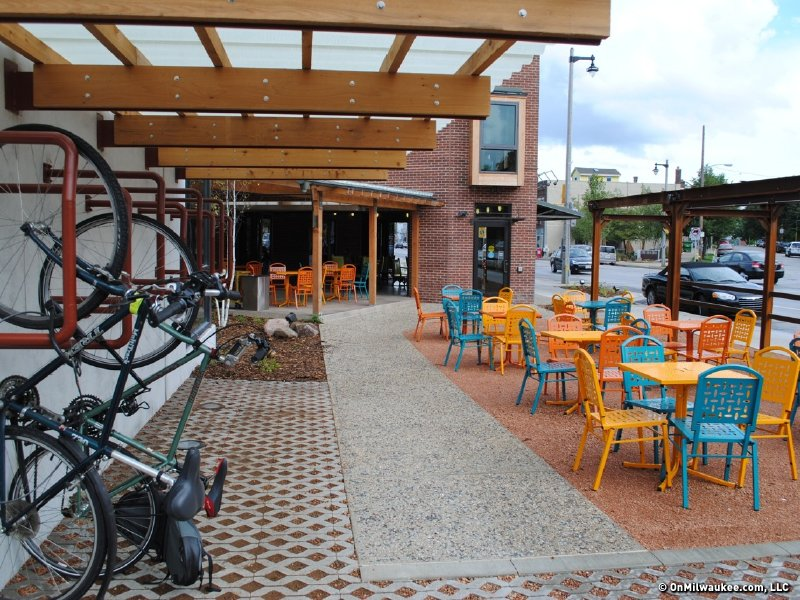 Vertical bike racks next to the open-air patio. (There's also a sheltered section).