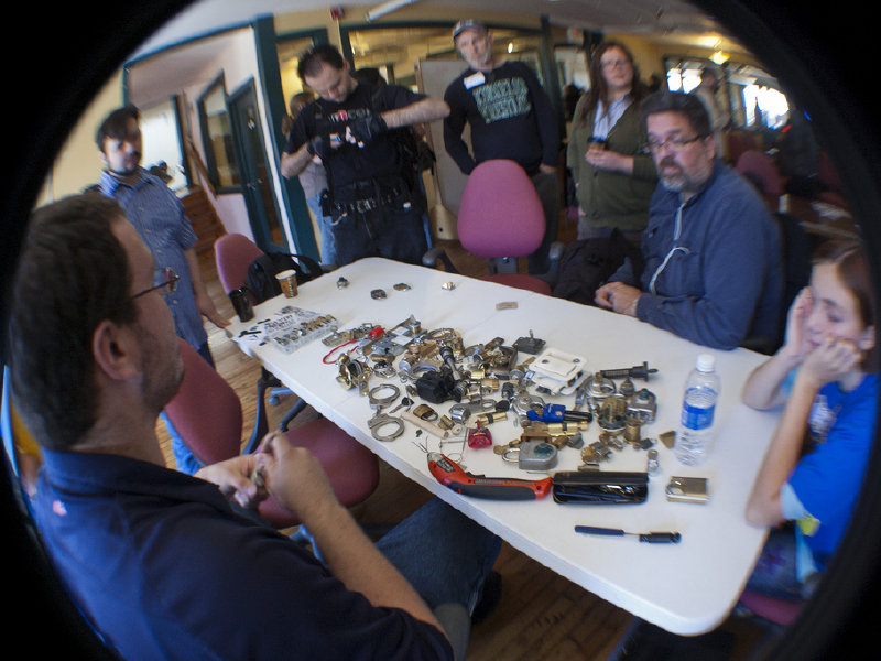 Participants learn how to spring locks at the Lock Picking Village. Photo: Pete Prodoehl (CC BY-NC-SA 2.0)