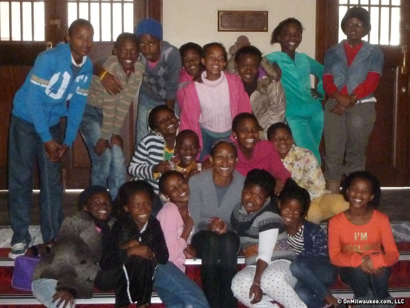 Marti Gobel surrounded by her students in Port Elizabeth, South Africa.
