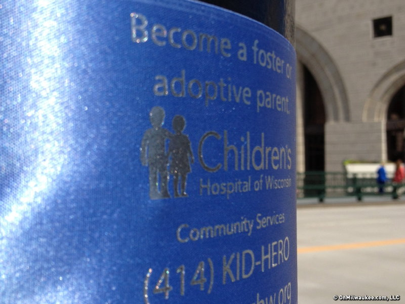 Blue ribbons are flying on several light posts along Wisconsin Avenue in Downtown Milwaukee.