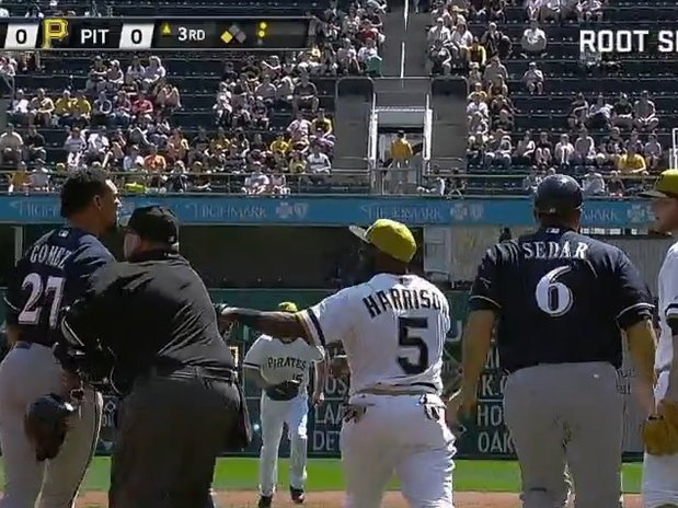 Carlos Gomez, left, and Pittsburgh Pirates pitcher Gerrit Cole, far right, began a bench-clearing ball on Sunday.