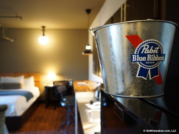 With a modern kitchenette and an urban rustic palette of steampunk touches  like gas pipe shelves and a reclaimed wood headboard, it's the stylistic  touches ... - Brewhouse Celebrates Milwaukee's Blue-ribbon Pabst Past, Boutique