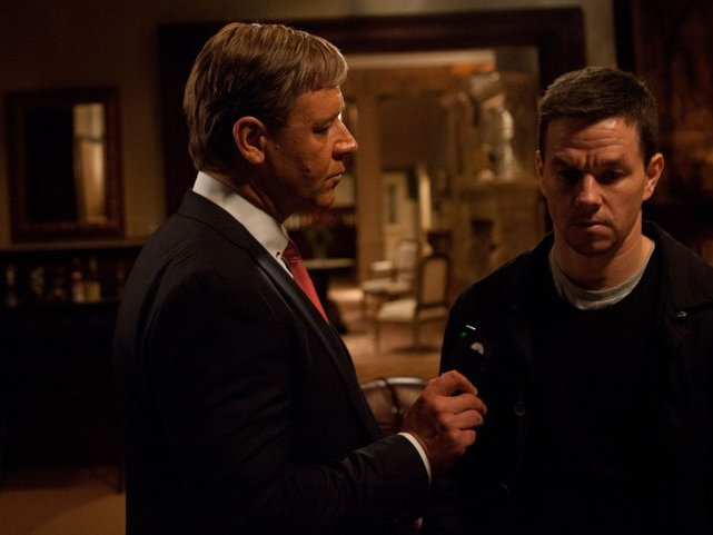 "Russell Crowe and Mark Wahlberg star in ""Broken City."""
