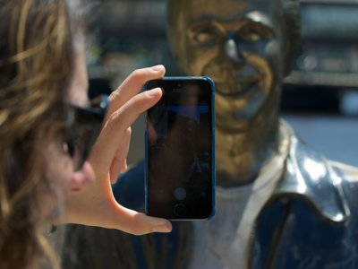 6 photos of people taking photos of the Bronze Fonz