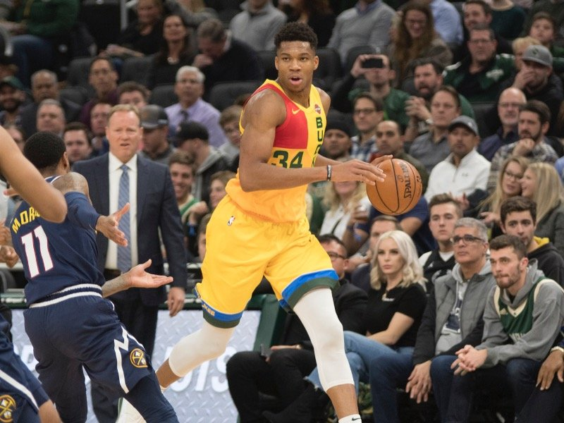5e47091e8 The Bucks debuted their new City Edition uniforms on the hardwood Monday  night with a 104-98 win over the Denver Nuggets.