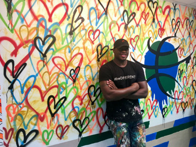 Desmond Mason paints mural at local youth organization, talks art and Bucks