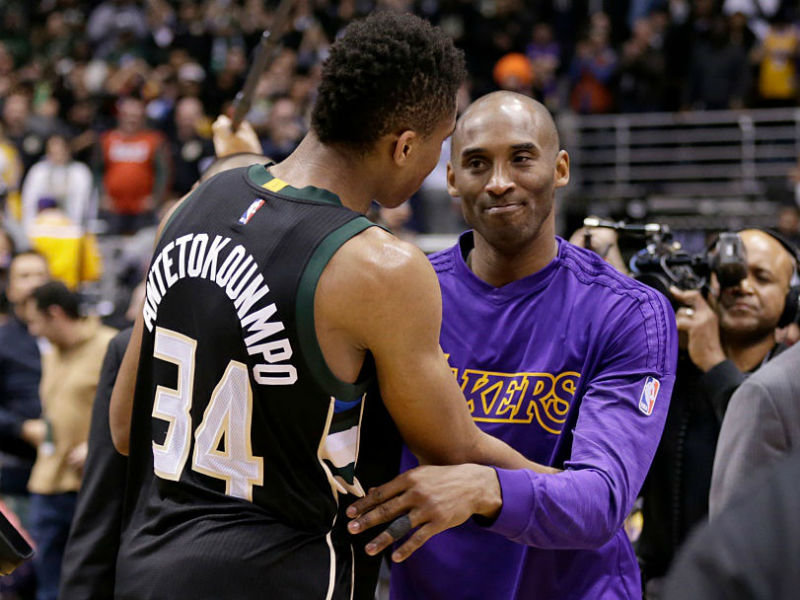 giannis antetokounmpo and kobe bryant embrace after a bucks win over the lakers in 2016