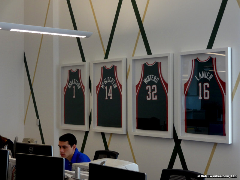 The Milwaukee Bucks paid homage to the team's history by hanging its retired jerseys in the new office as well.