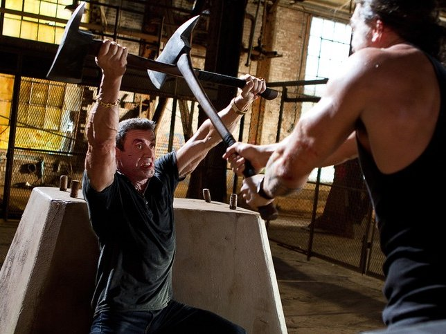 "Sylvester Stallone fights off Jason Momoa in ""Bullet to the Head."""