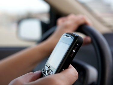 Texting while driving? Bad idea.  Driving and talking on the phone? Let's exercise some personal judgment.