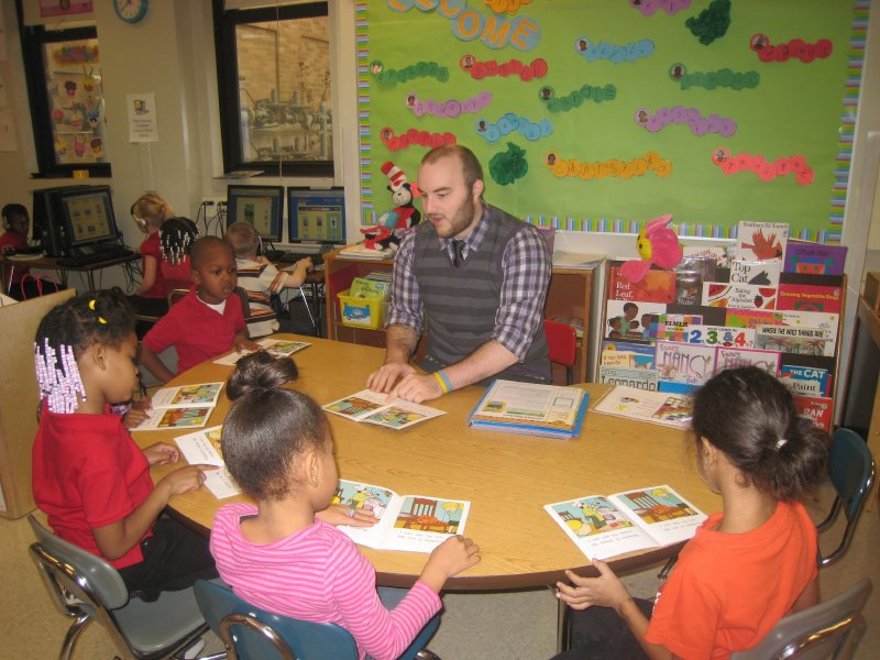 Kindergarten teacher Timothy Manley reads with kids at Milwaukee Academy of Chinese Language.