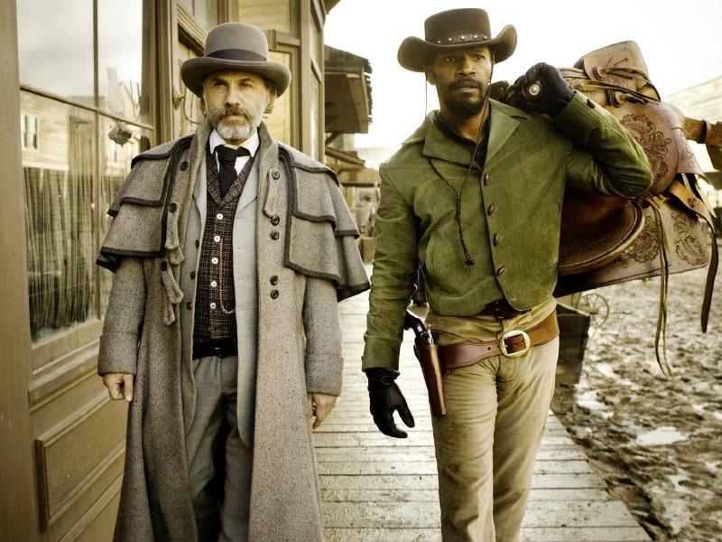 "Christoph Waltz and Jamie Foxx in ""Django Unchained,"" in theaters now."