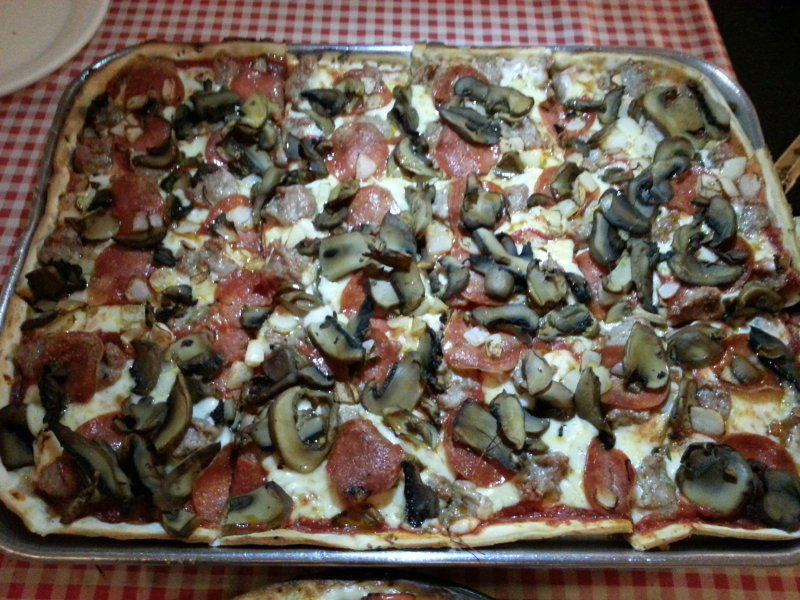 Sausage, pepperoni, mushroom and onion on thin crust.