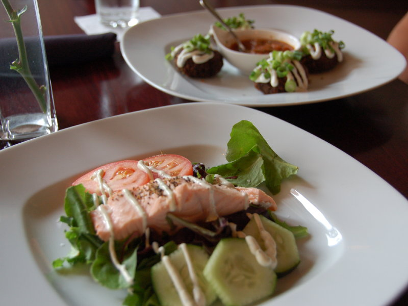 Swig's first course is a choice of poached salmon or black bean cakes.