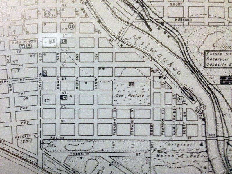 Here, I found that the Juneau (now Cass) School was located in a cow pasture that covered four blocks.