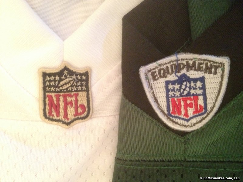 One way to tell a fake jersey is by examining the official league logo's. (The fake is on the right).