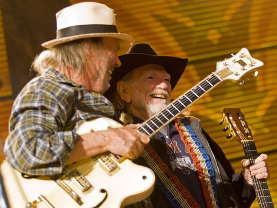 Neil Young (left) and Willie Nelson share the stage at Farm Aid.