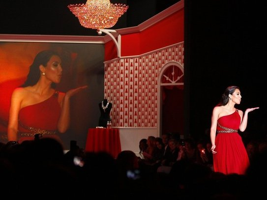 Kim Kardashian walks the runway during the Hearts Truth Red Dress 2010 collection during New York Fashion Week.