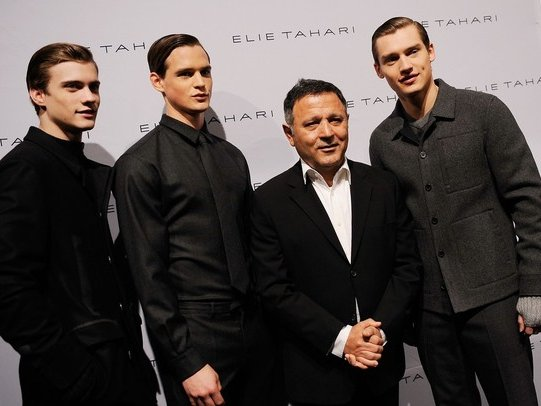 Designer Eli Tahari poses with models backstage at the Elie Tahari Fall 2010 Fashion Show.