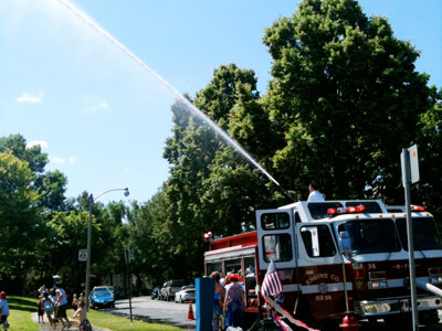 Firefighters invite neighbors to back to school block party