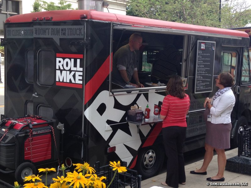 The Roll MKE food truck team in action.