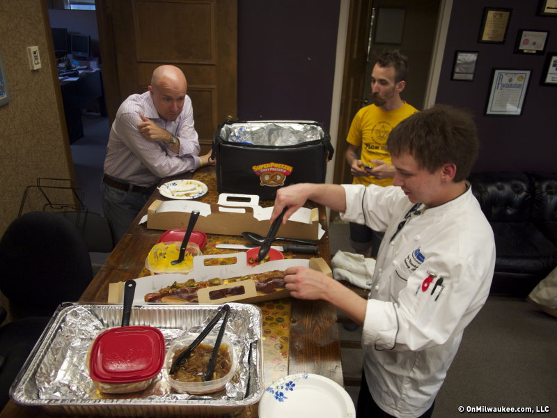 OnMilwaukee.com staff looks on as Chef Grant Newhouse prepares the Giant Slugger.