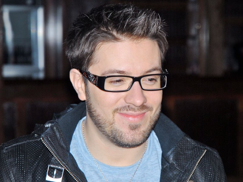 Danny Gokey's eye glasses are his trademark.
