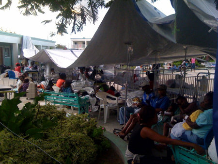 Families and individuals with nowhere to go have set up camp in the courtyard of St. Damien Hospital.