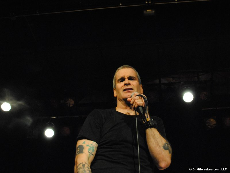 Henry Rollins, clearly annoyed with me for busting into the front row and taking photos.