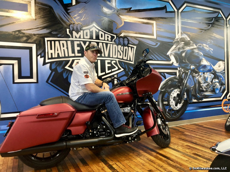 f14c7d11 House of Harley-Davidson owner Jeff Binkert in front of a custom-painted  mural at the dealership.