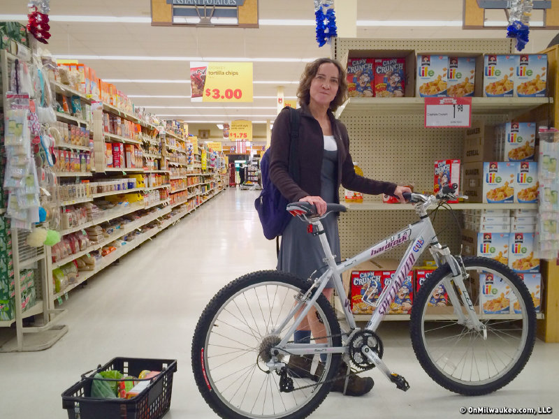 Karen Culver wheels her bike through the store when she doesn't have a lock.