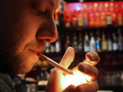 If smoking in a bar is illegal but you can just pay your way out of it, is there really a ban?