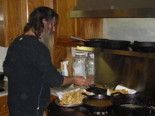 "Phil Robertson of ""Duck Dynasty"" prepares a meal at the Robertson family home featured on the A&E reality TV show."