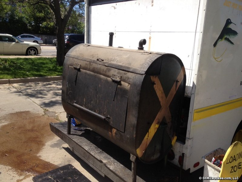 The big smoker on the back of the Jamaican Kitchen and Grill Food Truck prepares the food just right.