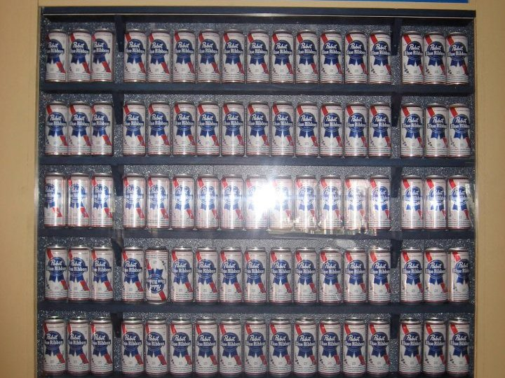 A wall of PBRs at J&B's Blue Ribbon Bar.