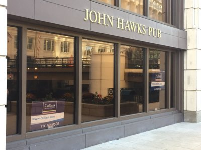 What should replace the old John Hawks Pub?