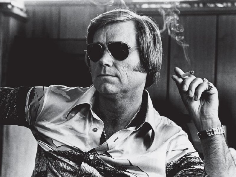 George Jones led a sad life. He drank and he sang about it. He lost at love and sang about that too.