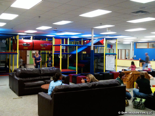 The main area has a climbing set and cushy chairs for parents.