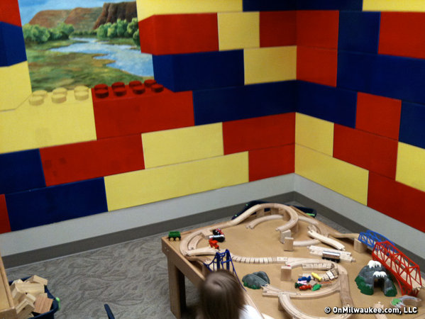 The train themed room lets kids build their own tracks and play with wooden trains.
