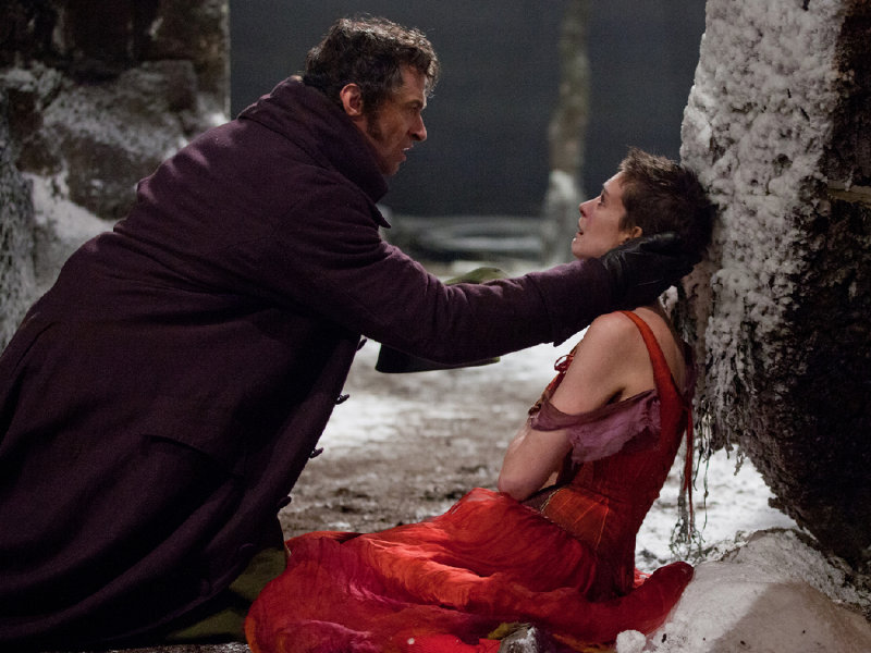 "Hugh Jackman and Anne Hathaway in ""Les Miserables,"" in theaters today."