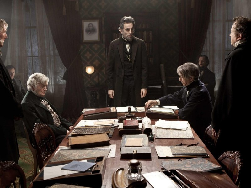 "Daniel Day-Lewis (center) as President Abraham Lincoln, with his advisors, in ""Lincoln,"" in theaters now."