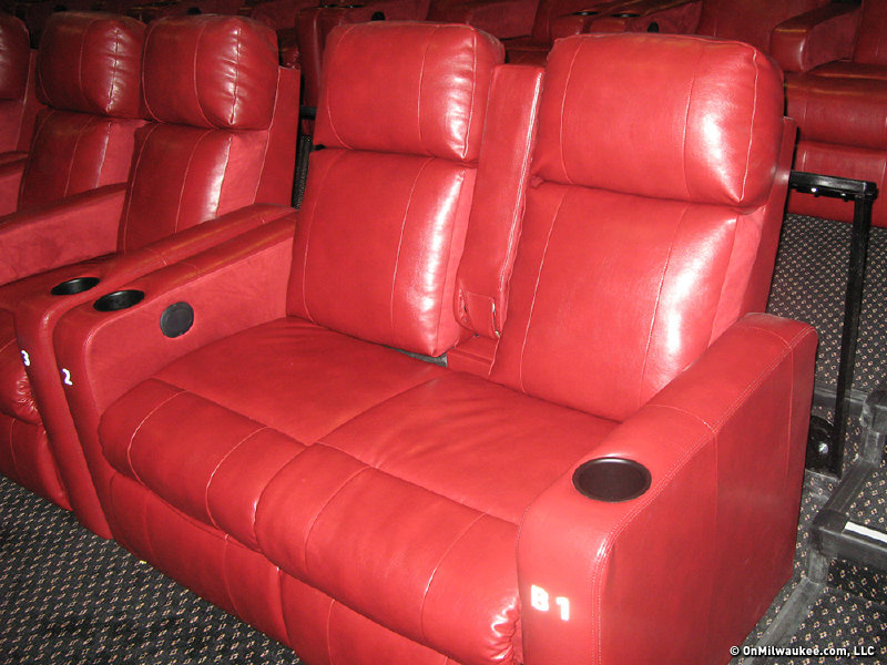 The DreamLounge chairs can convert to a loveseat by lifting the arm rest between a pair of recliners. & Renovations change movie-going experience - OnMilwaukee islam-shia.org