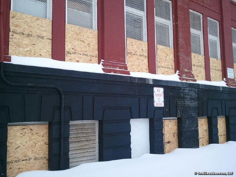 The windows at the former McKinley School were partially boarded up after a November fire.