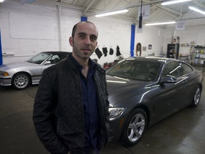 From grilling hot dogs to detailing cool cars, Muna puts customers first