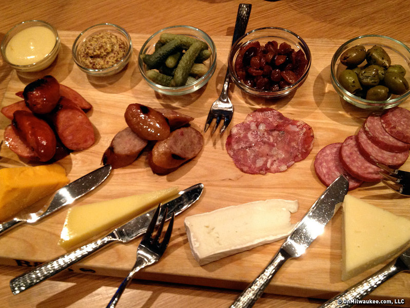 Millioke's build your own tasting board of Wisconsin cheese and charcuterie is a delight.